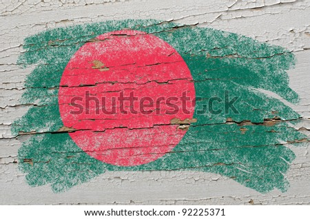 Chalky bangladesh flag painted with color chalk on grunge wooden texture - stock photo