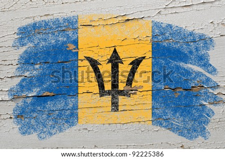 Chalky barbados flag painted with color chalk on grunge wooden texture - stock photo