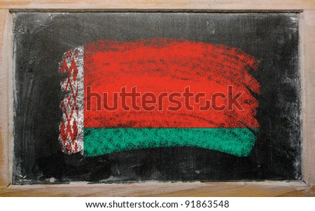 Chalky belarus flag painted with color chalk on old blackboard - stock photo