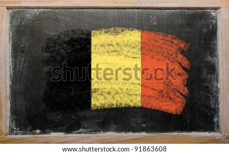 Chalky belgian flag painted with color chalk on old blackboard - stock photo