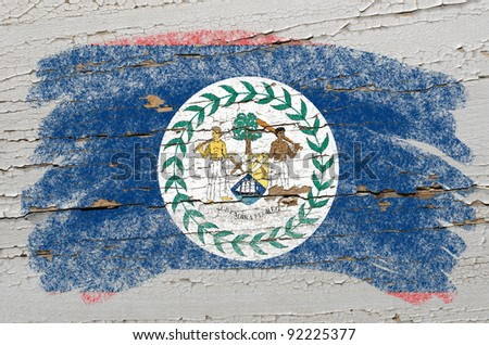 Chalky belize flag painted with color chalk on grunge wooden texture - stock photo