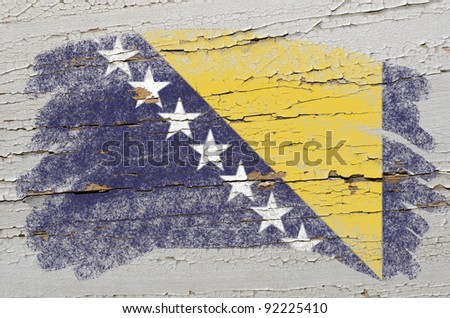 Chalky bosnia and herzegovina flag painted with color chalk on grunge wooden texture - stock photo