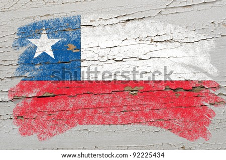 Chalky chile flag painted with color chalk on grunge wooden texture - stock photo