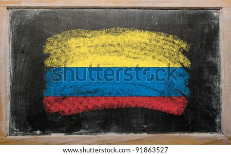 Chalky columbian flag painted with color chalk on old blackboard - stock photo