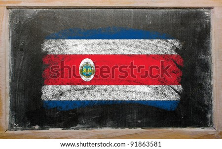 Chalky costa rica flag painted with color chalk on old blackboard - stock photo