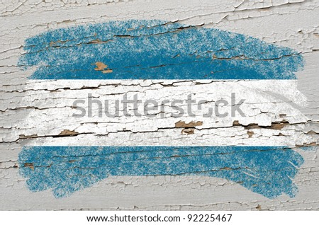 Chalky elsalvador flag painted with color chalk on grunge wooden texture - stock photo