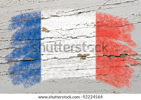 Chalky frech flag painted with color chalk on grunge wooden texture - stock photo