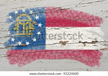 Chalky georgian flag painted with color chalk on grunge wooden texture - stock photo