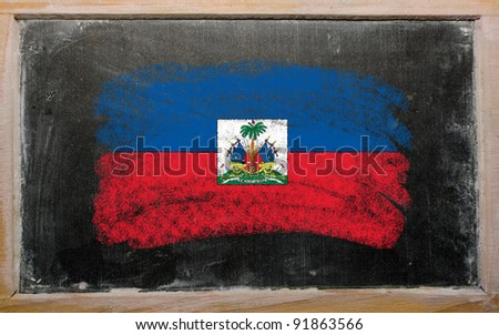 Chalky haitian flag painted with color chalk on old blackboard - stock photo