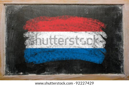 Chalky holland flag painted with color chalk on old blackboard - stock photo