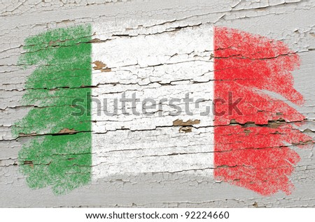 Chalky italian flag painted with color chalk on grunge wooden texture - stock photo