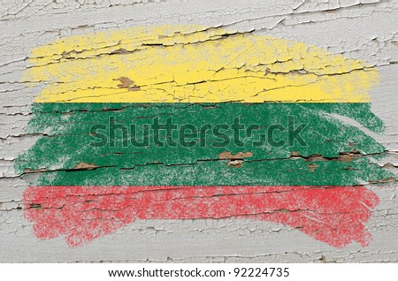 Chalky lithuanian flag painted with color chalk on grunge wooden texture - stock photo