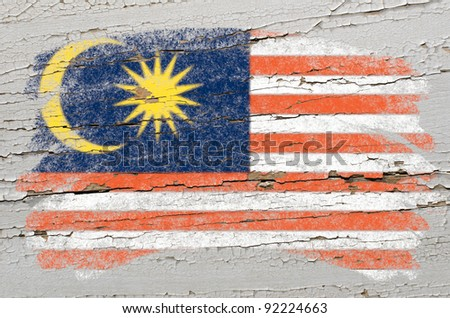 Chalky malaysian flag painted with color chalk on grunge wooden texture - stock photo