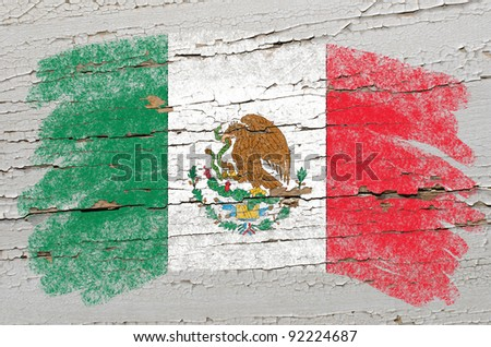 Chalky mexican, flag painted with color chalk on grunge wooden texture - stock photo