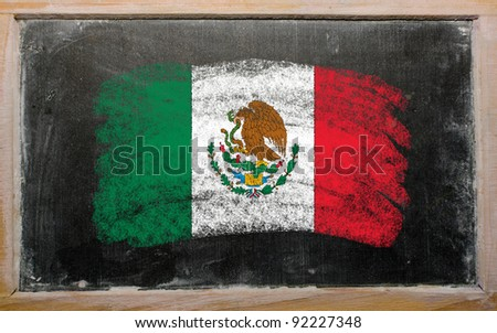 Chalky mexican flag painted with color chalk on old blackboard - stock photo