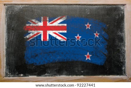 Chalky new zealand flag painted with color chalk on old blackboard - stock photo
