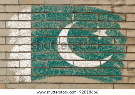 Chalky pakistan flag painted with color chalk on grunge old brick wall - stock photo