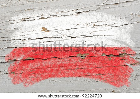 Chalky polish flag painted with color chalk on grunge wooden texture - stock photo
