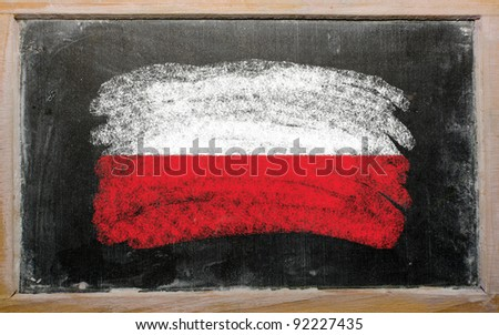 Chalky polish flag painted with color chalk on old blackboard - stock photo