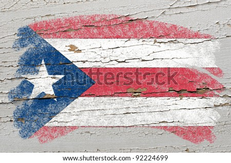 Chalky puertorican flag painted with color chalk on grunge wooden texture - stock photo