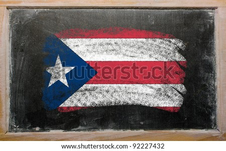 Chalky puertorican flag painted with color chalk on old blackboard - stock photo