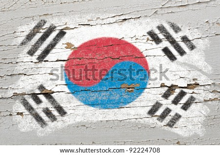 Chalky south korean flag painted with color chalk on grunge wooden texture - stock photo