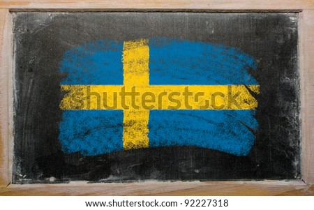 Chalky Swedish flag painted with color chalk on old blackboard - stock photo