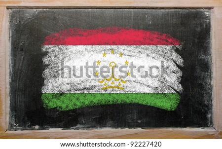 Chalky tajikistan flag painted with color chalk on old blackboard - stock photo