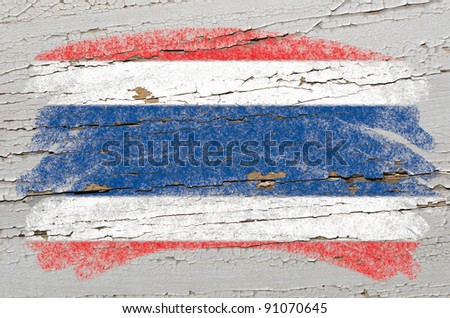 Chalky thai flag painted with color chalk on grunge wooden texture - stock photo