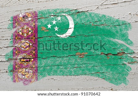 Chalky turkmenistan flag painted with color chalk on grunge wooden texture - stock photo