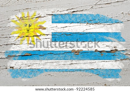 Chalky uruguay flag painted with color chalk on grunge wooden texture - stock photo