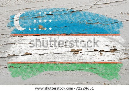 Chalky uzbekistan flag painted with color chalk on grunge wooden texture - stock photo