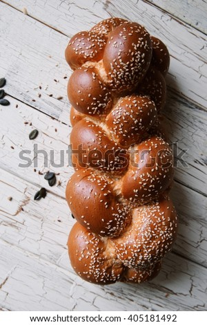 Challah bread on white wood background - stock photo