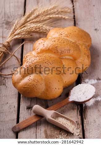 Challah bread with sesame seeds. Pastry,flour and sesame seeds.selective focus. - stock photo