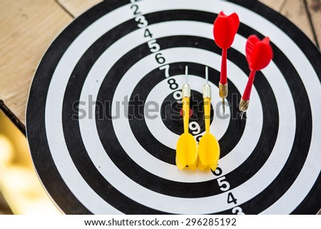 Challenge concept with darts, selective focus on red arrow - stock photo