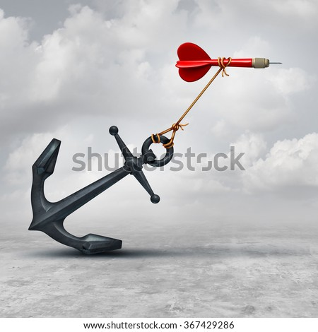 Challenges in business as a dart being slowed down by a heavy anchor as an adversity metaphor and symbol or overcoming a handicap to achieve your goal to reach the target. - stock photo