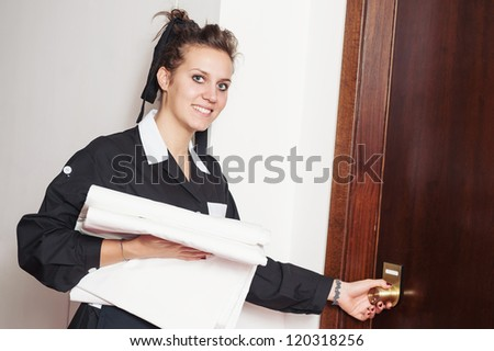 Chambermaid woman during room service in a hotel.