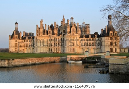Chambord castle in Loire valley , central France. Sunset light - stock photo