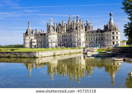 Chambord Chateau reflected in the canal, France - stock photo
