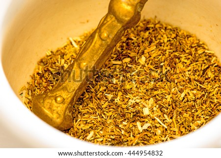 Chamomile, dried with mortar - stock photo