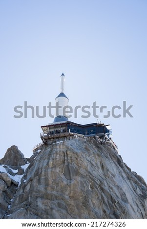CHAMONIX, FRANCE - SEPTEMBER 02: Low angle shot of Aiguille du Midi complex. At 3842 meters, the complex offers close views of the Mont Blanc summit. September 02, 2014 in Chamonix. - stock photo