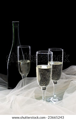 Champagne against a black background - stock photo