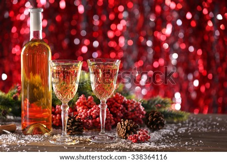 Champagne and Christmas decoration on bright background - stock photo