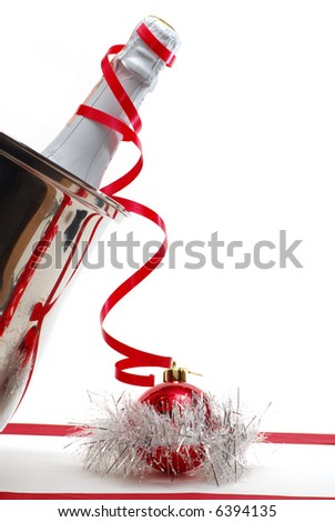Champagne and Christmas decoration on white background - stock photo