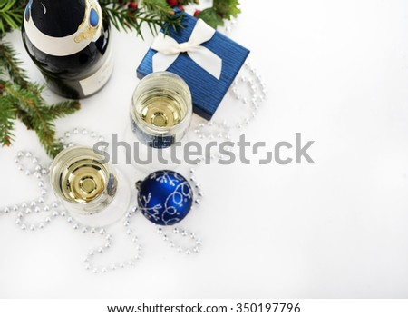 Champagne and christmas decoration over white background - stock photo