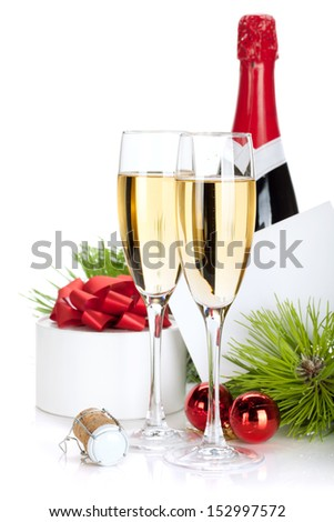 Champagne and christmas gifts. Isolated on white background - stock photo