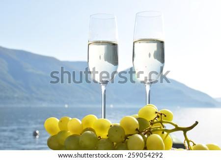 Champagne and grapes. Lake Maggiore, Switzerland - stock photo