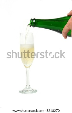 champagne  being poured into a wine glass - stock photo