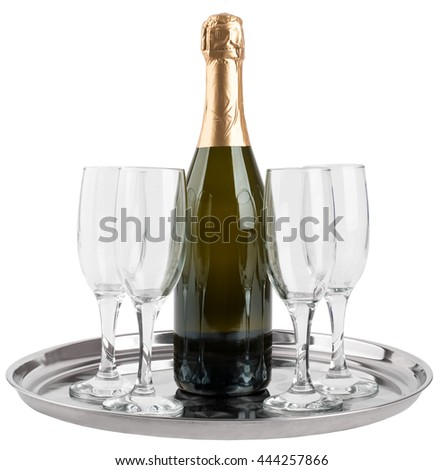 Champagne bottle and four champagne glasses on tray isolated on white background - stock photo