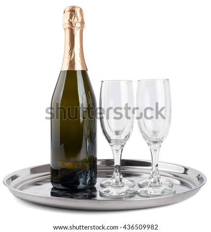 Champagne bottle and two champagne glasses on tray isolated on white background - stock photo